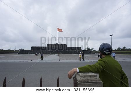 Hue, Thua Thien-hue, Vietnam - February 27, 2011:  Vietnamese Guard Observing The People Around The