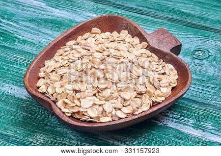 Healthy Cereal Seeds. Mountain Oat Flakes On A Wooden Table.