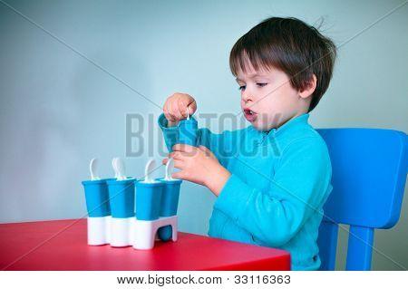Little boy opening homemade ice cream