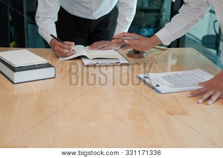 Lawyer Give Advice To Man. Businessman Discussing Legal Legislation At Law Firm. Judge Team Meeting