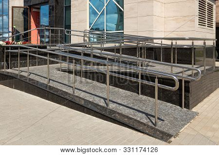 Wheelchair Ramp Of Two Uneven Horizontal Surfaces, Street View, Window With Sky Reflection.