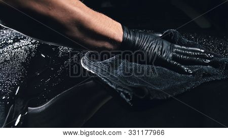 Using Rag In Palm Of Your Hand, Drops Are Removed From The Car. Drop Flow Down The Hood. Close Up Vi