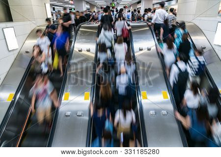 Crowd Of Pedestrians Unrecognizable Walking In Escalator In Rush Hour Morning Before Working Time In