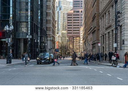 Boston, Usa - Mar 2019 : Unrecognizable Crowd Pedestrians And Traffic Road Intersection Around Bosto
