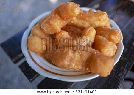 Deep-fried Dough Stick , Eaten With Morning Coffee