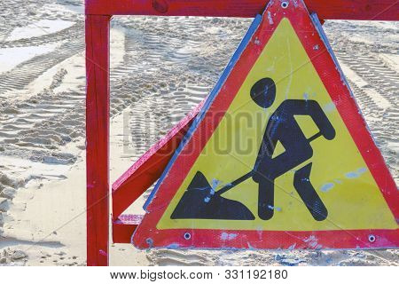 Warning Of Repair Or Construction Of A Road Triangular Road Sign. Located At The Place Of Work Of Co