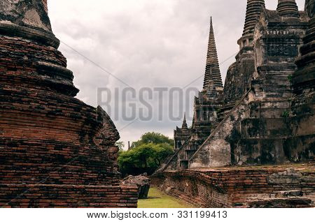 Historic City Of Ayutthaya With Red Brick And Stone Facade Architecture - Ancient Remains Of Buddhis