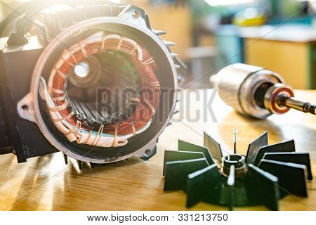 Close-up Of A Disassembled Part From A Automotive System Lies On A Table In The Manufacture Of Autom