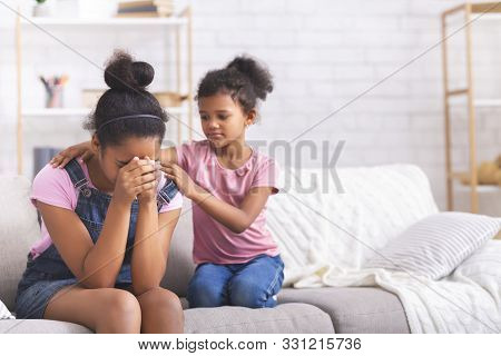 Sincere Child Support. Little African Girl Comforting Her Crying Teen Sister With Relationship Probl