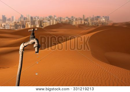 Dripping Faucet, Desert And Skyline Of Big City In The Background, Concept Of Global Warming Planet,