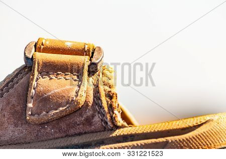Macro Closeup Shot Of A Front Part Of A Leather Sandal With Stitched Seams Around The Perimeter Of T