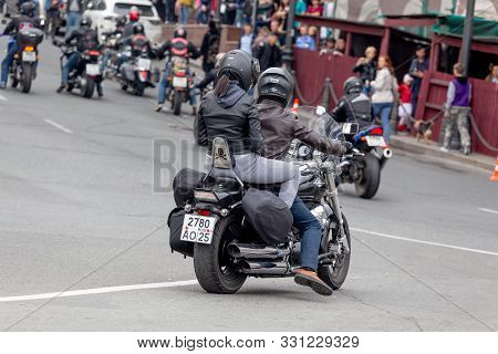 Russia, Vladivostok, 10/06/2018. Biker Rides The Bike (motorcycle) In The City Downtown. Riding With