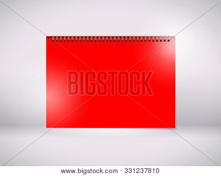 A Red Paper With A Black Wiro Bind