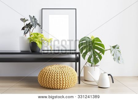 Bright Living Room With Plant Table, Houseplants, Pouf And Blank Picture Frame, Copy Space