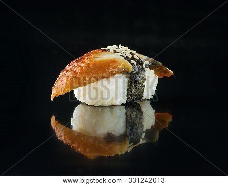 Unagi Sushi With Smoked Eel On A Black Background
