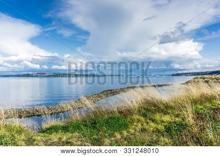 Billowing Clouds Hover Over The Puget Sound And Homes In Tacoma, Washington.