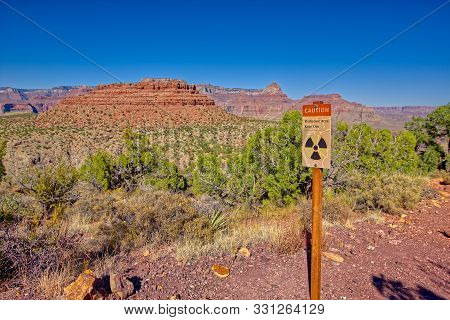 A warning sign for radioactivity from an abandoned Uranium Mine in the area of Horseshoe Mesa at the Grand Canyon. poster