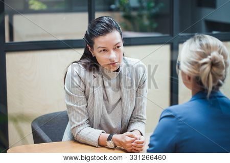 Job Interview Or Business Meeting Face - To-face. Two Business Women At A Meeting. Recruiter And The