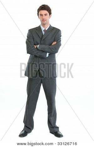 Full Length Portrait Of Authoritative Modern Businessman
