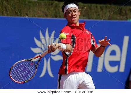 BARCELONA - APRIL, 25: Japanese tennis player Kei Nishikori in action during his match against Mikhail Kukushkin of Barcelona tennis tournament Conde de Godo on April 25, 2012 in Barcelona