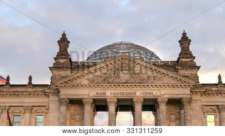 Close Up Of The Reichstag Pediment And Dome In Berlin, Germany