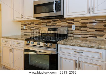Amazing New Contemporary White Kitchen And Gas Stove With New Oven