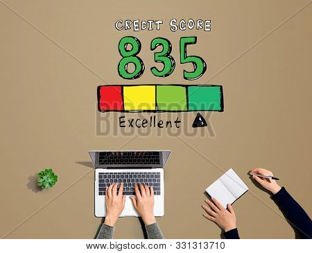 Excellent Credit Score Theme With People Working Together With Laptop And Notebook
