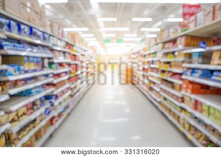 Blurred Of Variety Of Goods On The Shelves In The Supermarket