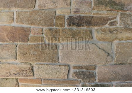 Close Up Of Rectangular Gray Brown Stone Brick Wall Building, Rustic Architectural Design Background