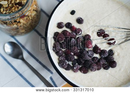 Blackberry In Metallic Bowl With Batter And Whisk On Wooden Table, Cooking Homemade Oladyi Or Pancak