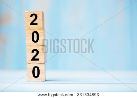 2020 New Year Wooden Cubes On Blue Table Background With Copy Space For Text. Business Goals, Missio