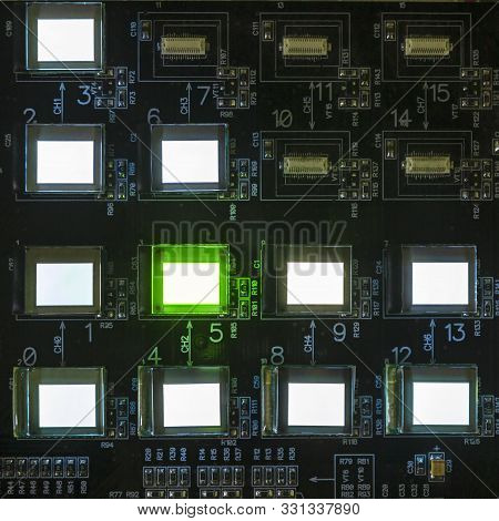 The Process Of Checking Several Oled Displays On The Test Station. Displays Glow Brightly Of Green A