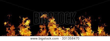 Real Fire Line Flames Isolated On Black Background. Mockup Fire Wall.