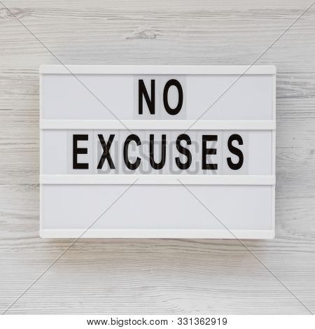 'no Excuses' Words On A Lightbox On A White Wooden Surface, Top View. Overhead, From Above, Flat Lay