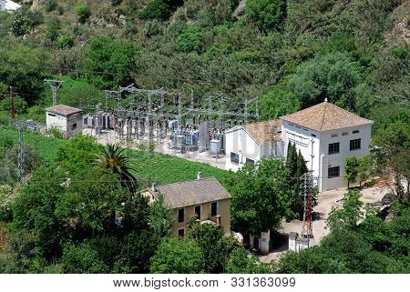 Alora, Spain - May 13, 2008 - Elevated View Of The Electricity Sub Station Surrounded By Trees, Alor