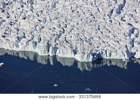 Advanced glacier calving in the Arctic Ocean - aerial view