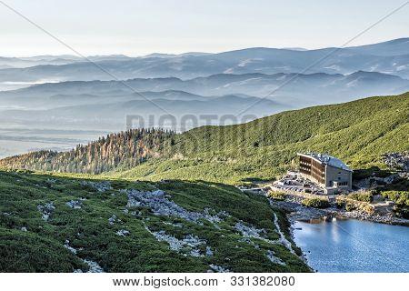 Hotel Sliezsky Dom And Velicky Tarn In High Tatras Mountains, Slovak Republic. Hiking Theme. Travel