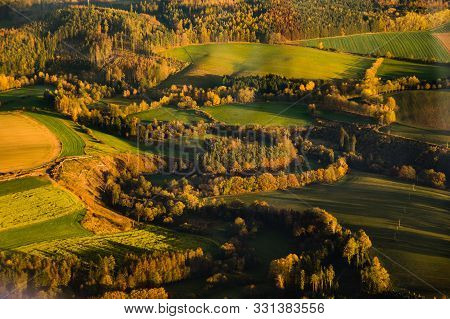 Aerial Photograph Of Sunset Over Czech Highlands With Farmlands And Forrests