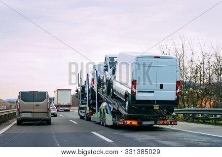 Minivan Carrier Transporter Truck In Road Auto Vehicles