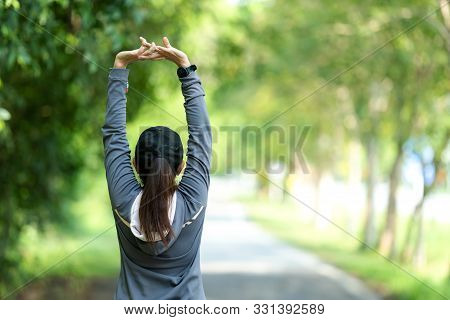 Healthy Woman Warming Up Stretching Her Arms. Asian Runner Woman Workout Before Fitness And Jogging
