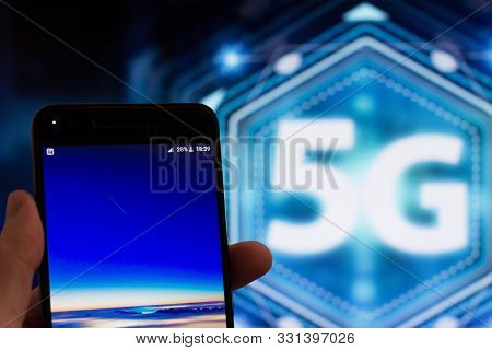 Man Holding Smartphone. 5g Touch Screen Inteface Button On The Background, Los Angeles, California -