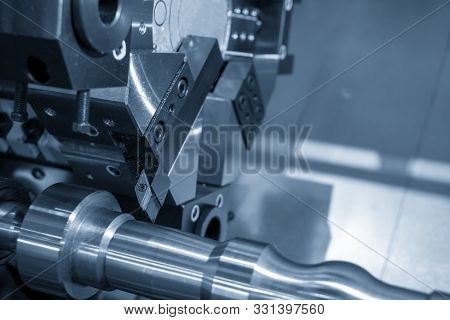 The Operation Of Multi-tasking Cnc Lathe Machine Cutting The Metal Shaft Parts In The Light Blue Sce