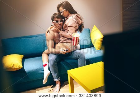 Young Couple Have Intimacy In Kitchen In Night. Hot Seductive And Sensual Woman Sit On Guys Legs In