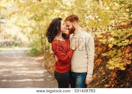 Portrait Of Beautiful Couple Man Woman In Love. Boyfriend And Girlfriend Hugging Kissing Outdoor In