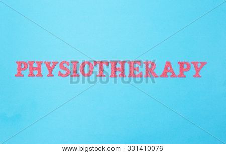 The Word Physiotherapy On A Blue Background. The Concept Of Treating A Person With Physiotherapy, Hi