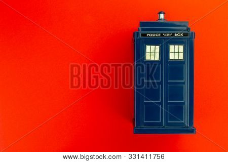 Police Call Box In Front Of Red Background Flat Lay. Tardis From Doctor Who.