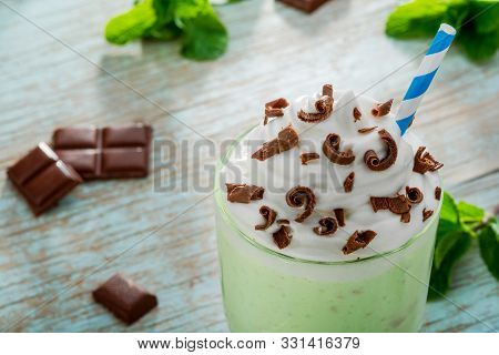 Seductive Mint Milkshake For Sweet Tooth Consists Of Ice Cream With Milk. Pieces Of Chocolate And Le