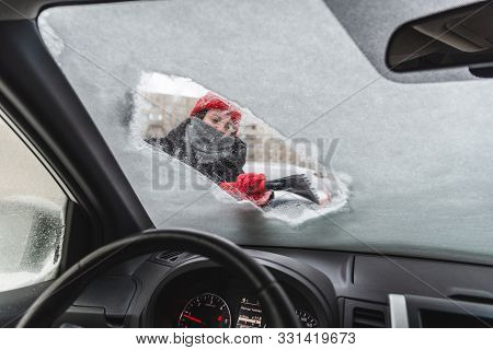 Young Pretty Woman Cleaning Car After Snow Storm