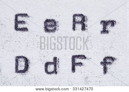 Real Typewriter Font Alphabet With Letters E, R, D, F On White Paper. Macro Shot