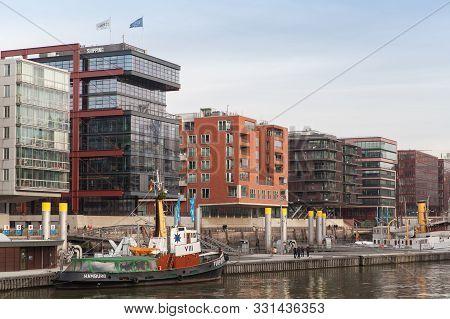 Hamburg, Germany - November 30, 2018: Hafencity Street View With Ships Moored At Ponton 1